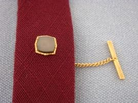 1970's signed SOPHOS grey shell and gold plated tie tack.