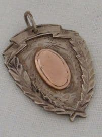 A Silver and Rose Gold Sporting Shield Fob - Hallmarked Birmingham 1921