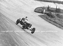 DUESENBERG Indianapolis Car.Photo. Whitney Straight at speed, Brooklands  1934