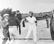 Hon Victoria Worsley & R Latham Boote passing the baton,  Brooklands relay race c.1931
