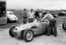 HWM Stirling Moss in the paddock Goodwood 1950