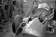 Maserati 250F mechanic Alf Francis in Moss's car. Oulton Park paddock 1954 Gold Cup