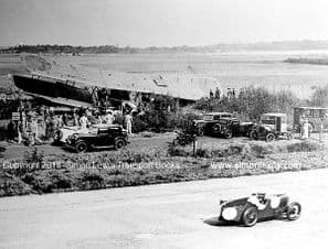 MG at Brooklands with crashed RAF Plane trackside. Unknown date and driver.
