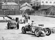MG R Type Dennis Evans leads Riley, MG,ERA,Bugatti 35 Empire Trophy. Brooklands.  Photo
