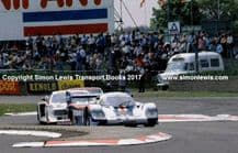 Porsche 956 . Jacky Ickx at speed leads Lancia Beta.  Silverstone 6 Hours Group C 1982